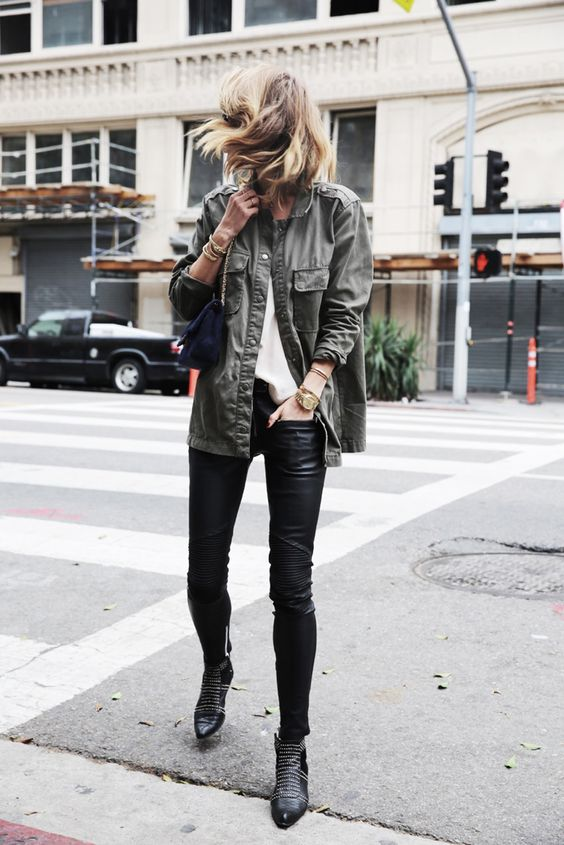 Anine Bing exudes tomboy vibes in a khaki jacket and studded boots.Outfit: Anine Bing (Brand).: